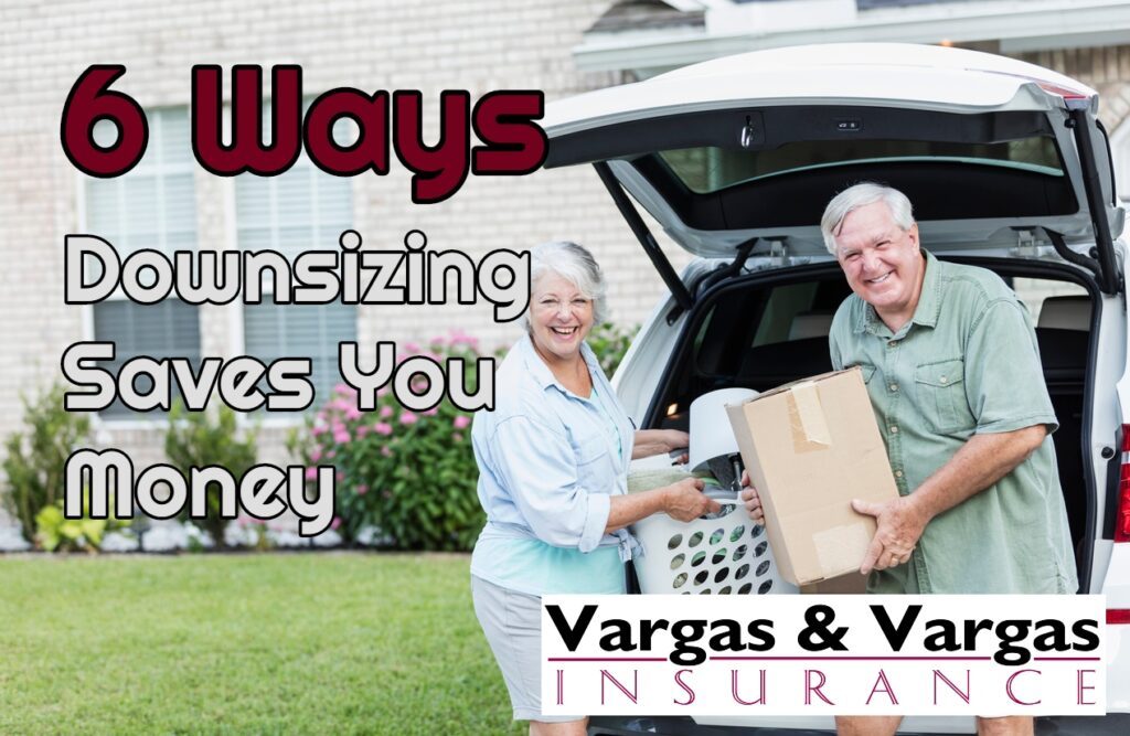 older couple unpacking in front of their new home while downsizing