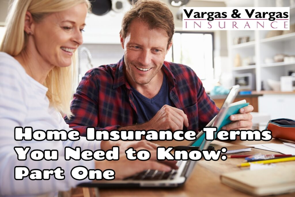 couple researching home insurance terms in their kitchen