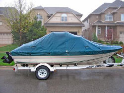 Prepare Your Boat for Fun in the Sun - Boat with tarp and trailer.jpg